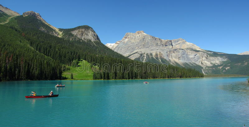 Red Canoes on Glacial Emerald Lake, Yoho National Park, British Columbia, Canada royalty free stock images