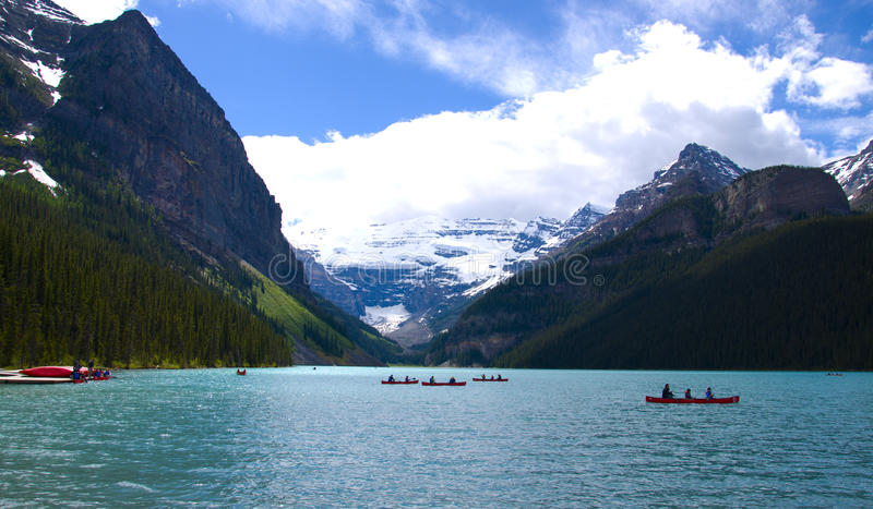 Canoes in lake louise. Banff national park, canada royalty free stock photo
