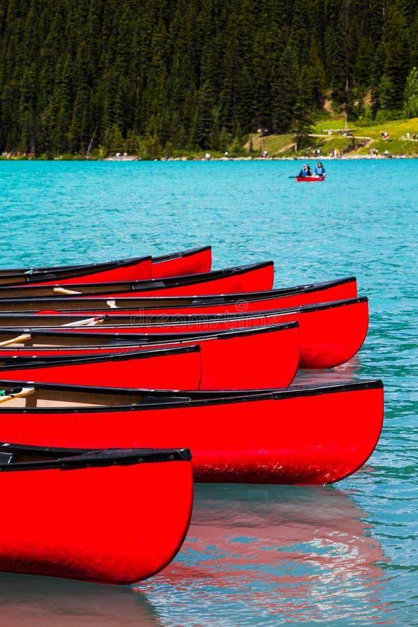 Canoes at Lake Louise, Banff National Park, Canada. Row of red canoes at Lake Louise, Banff National Park, Canada royalty free stock photography