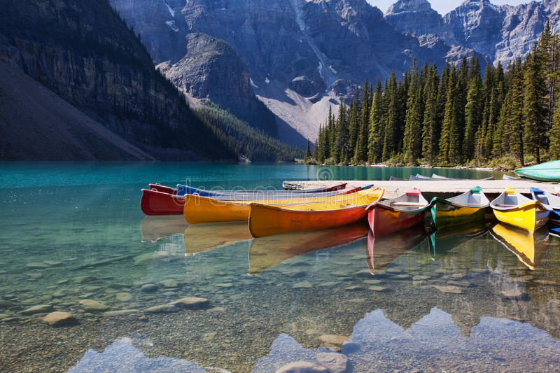Canoes on Moraine Lake royalty free stock photography