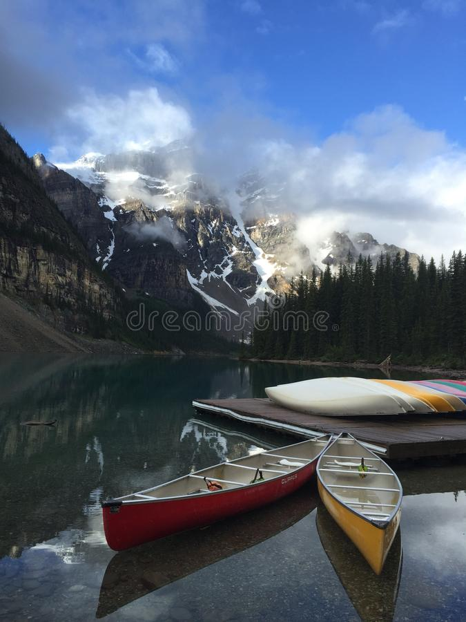 Canoes in Moraine Lake, Banff National Park, Alberta, Canada, royalty free stock photos