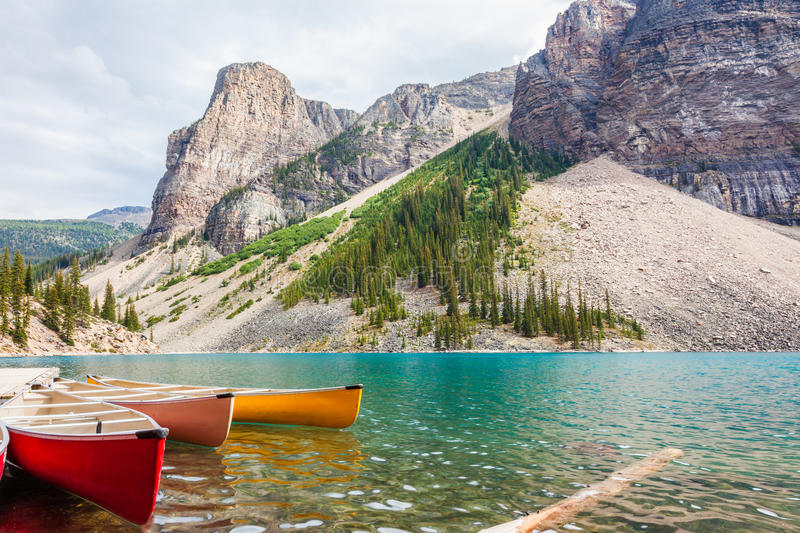 Canoes rental point at Moraine Lake royalty free stock images