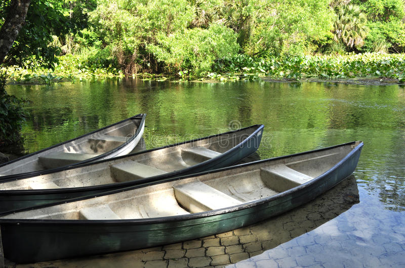 Canoes on a River. An image of a 3 Canoes on a River stock photos