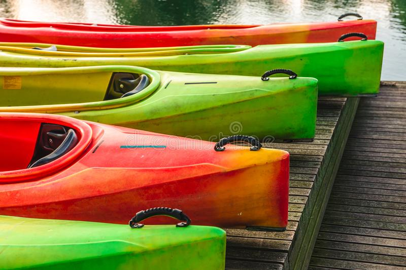 Canoes standing on the wooden platform. Ready for season royalty free stock image