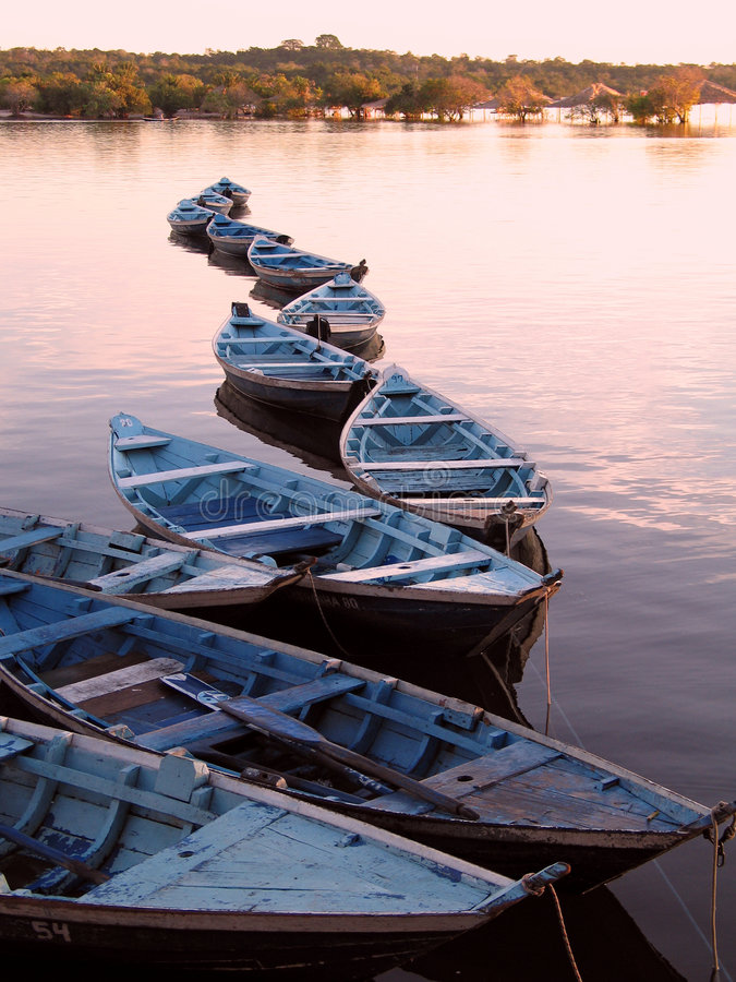Canoes in sunset stock photography