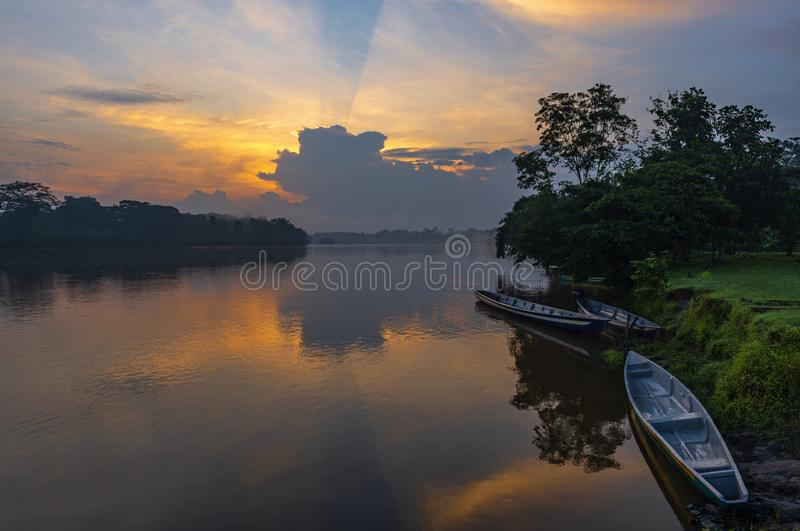 Canoes at Sunset in the Amazon River Basin, Ecuador royalty free stock photography