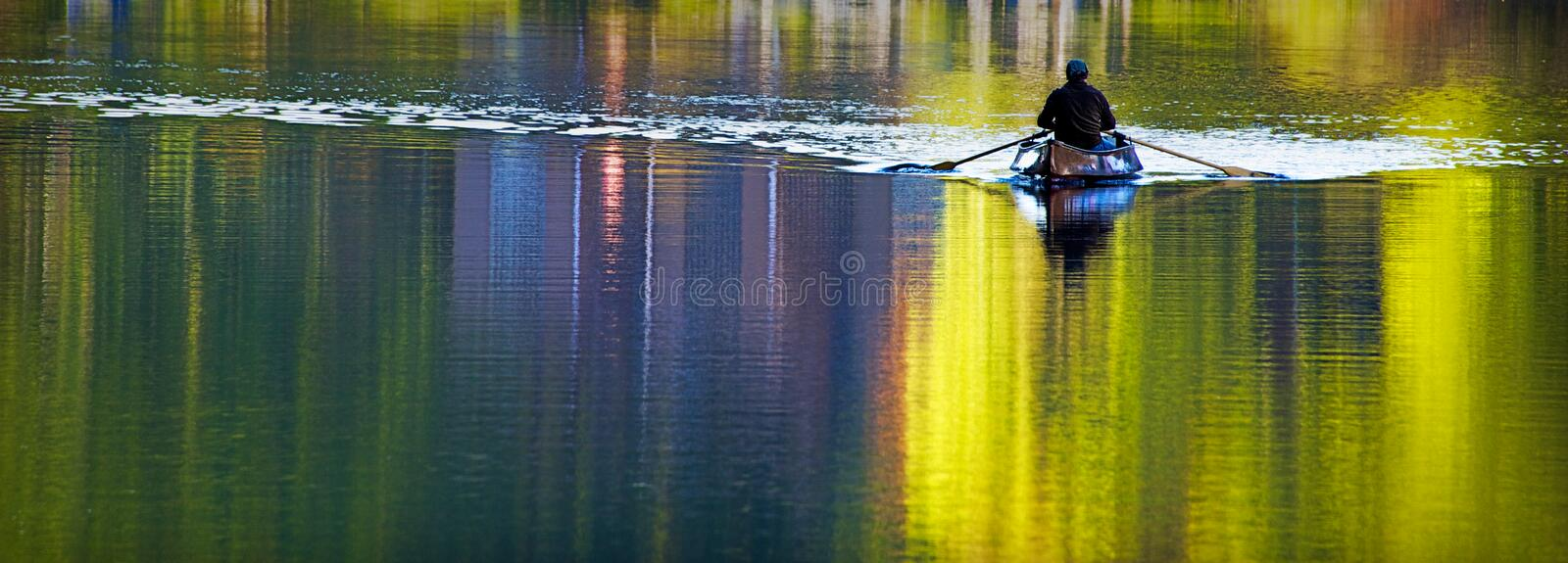Canoing in Autumn royalty free stock image