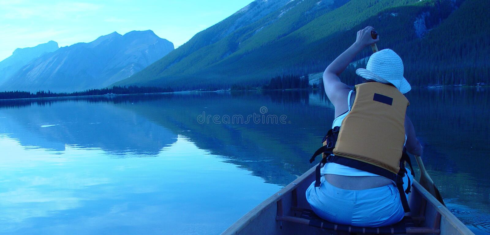 Canoing at sunset royalty free stock images