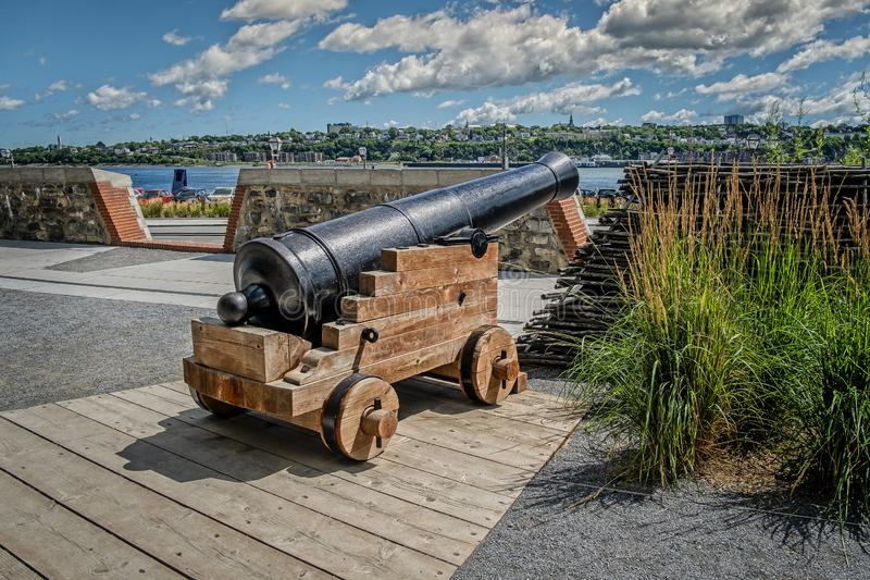 Canon at the Batterie royale Québec. Old Quebec French: Vieux-Québec is a historic neighbourhood of Quebec City, Quebec, Canada. Comprising the Upper Town royalty free stock image