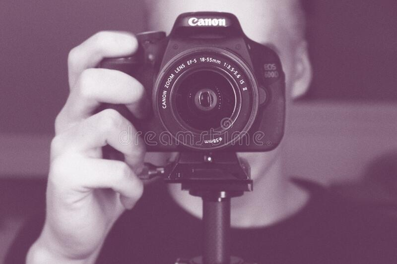 Canon camera and photographer stock images