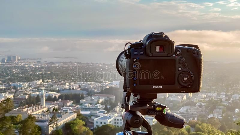 Canon 5D Mark IV on a Manfrotto tripod at Grizzly Peak in Berkeley Hills pointing at San Francisco covered with fog at sunset. Berkeley, United States - July 12 royalty free stock photo