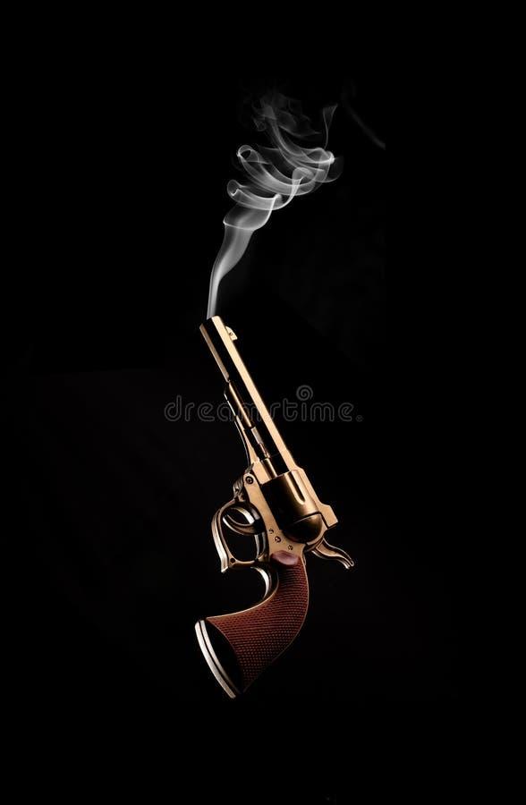 Canon et fumée anciens photographie stock libre de droits