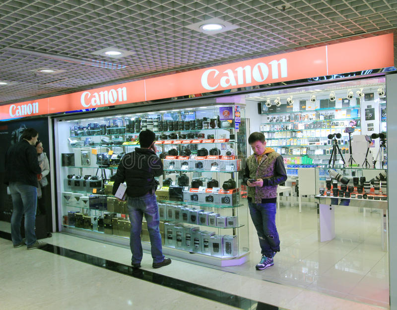 Canon font des emplettes à Hong Kong photo stock