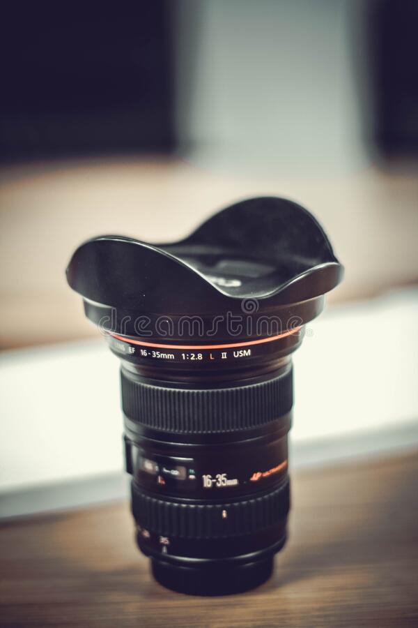 Canon lens on table royalty free stock photos