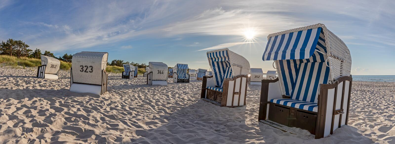 Beach with Canopied beach chairs in evening light stock photos
