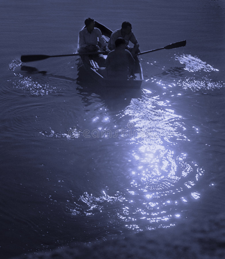 Canotage de clair de lune photos stock