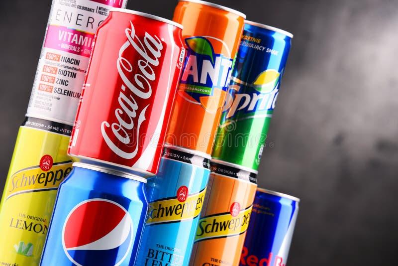 Cans av blandade globala läsk royaltyfria bilder