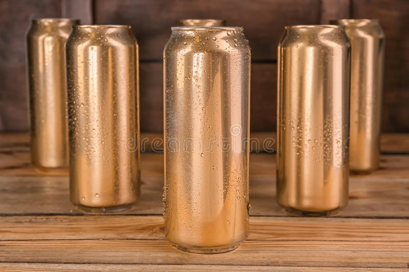 Cans of beer on table. Cans of beer on wooden table royalty free stock photo
