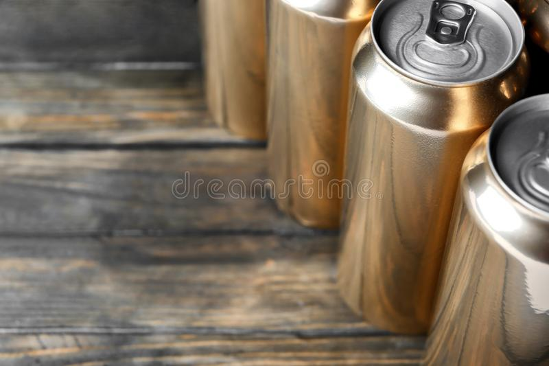 Cans of beer on wooden background, royalty free stock image