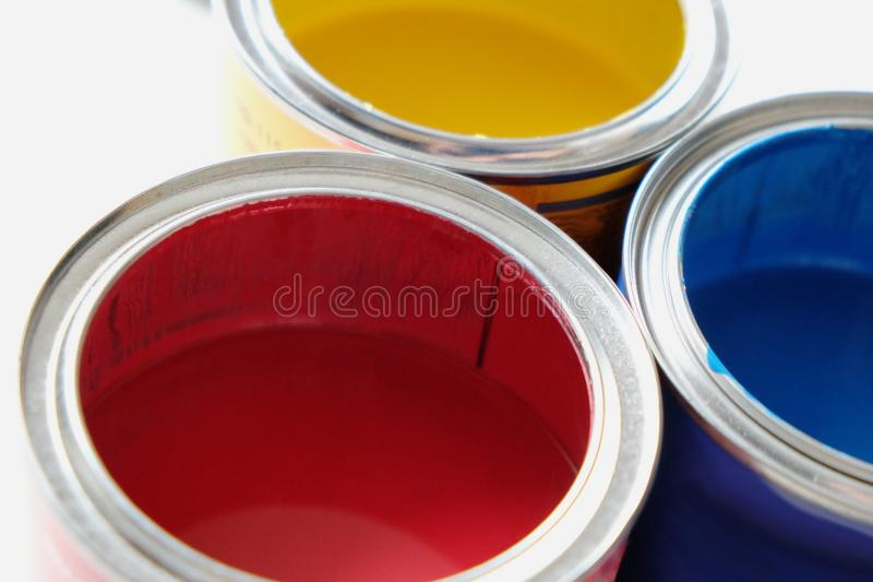 Cans of colored paints. Open cans of colored paints stock images