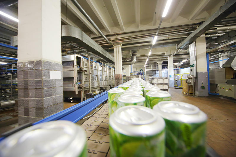 Cans with drink mojito on conveyor in Ochakovo. MOSCOW - MAY 16: Cans with drink mojito on conveyor in Ochakovo factory, on May 16, 2012 in Moscow, Russia stock images