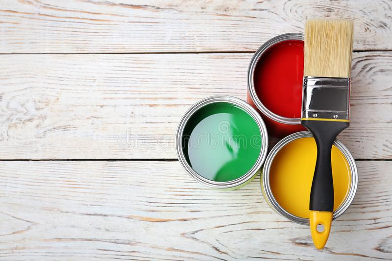 Cans with paint and brush royalty free stock images