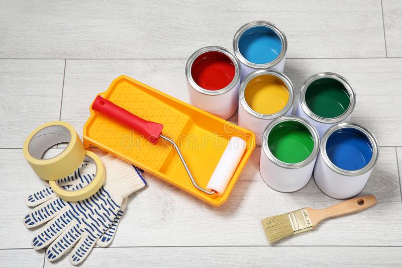 Cans of paint and decorator tools stock photos