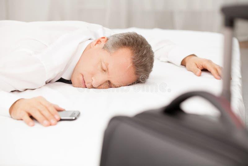 Cansado y con exceso de trabajo. fotografía de archivo libre de regalías