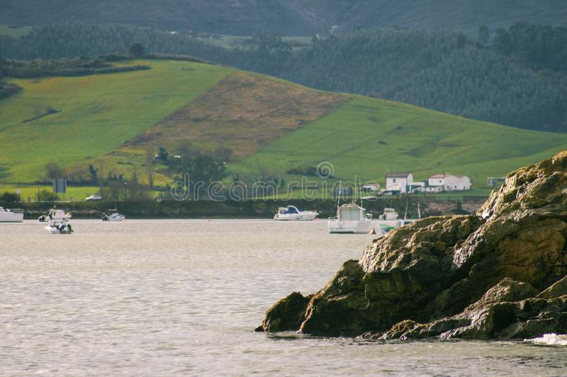 Entrance to the port of San Vicente de la Barquera with the Cantabrian mountain range in the background. Cantabrian sea with background of the Cantabrian royalty free stock photo