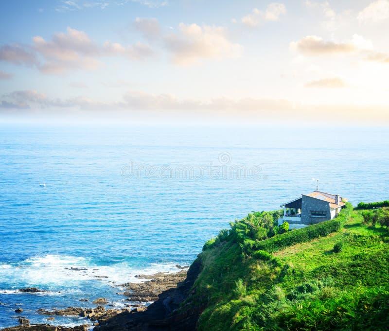 Cantabrian Sea coast. Cantabrian Sea green coast at sunset, Pais Vasco Spain, toned royalty free stock photography