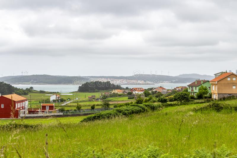 Cantabrian Sea coastline in Galicia, Spain. Overcast summer Cantabrian Sea coastline view with Merexo and Camarinas in the background on the Way of St. James stock images