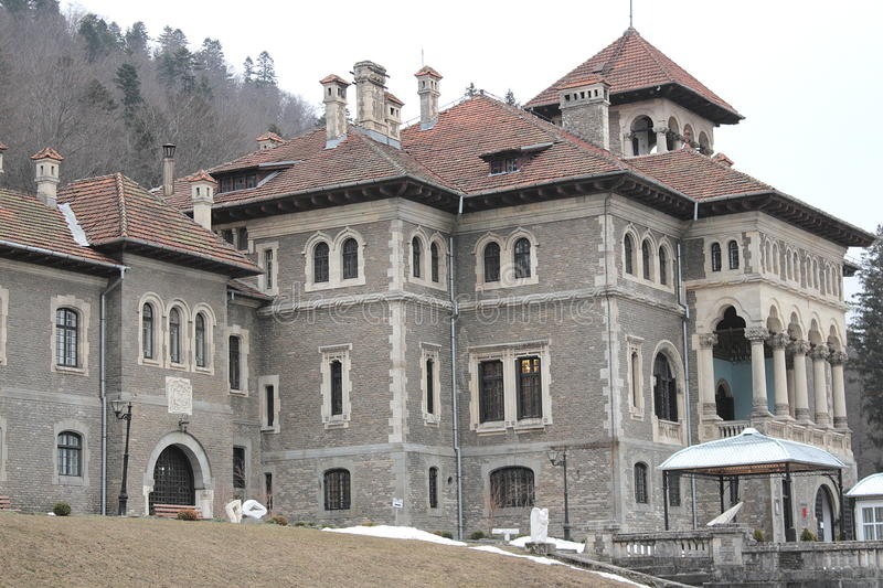 Cantacuzino Castle in winter with yard view. Cantacuzino Castle from Busteni, Romania is one of great architectural, historical, documentary and artistic value stock photography