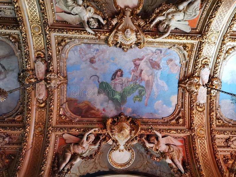 Cantacuzino Palace interior - ceiling painted and angels. Carved in french baroque style royalty free stock image