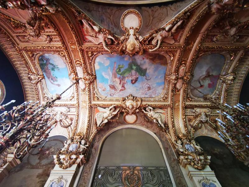 Cantacuzino Palace interior - ceiling paintings. And angels on the ceiling. French baroque style stock photos