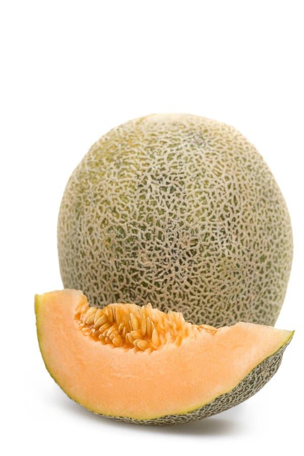 Cantaloupe. One cantaloupe and a half royalty free stock image