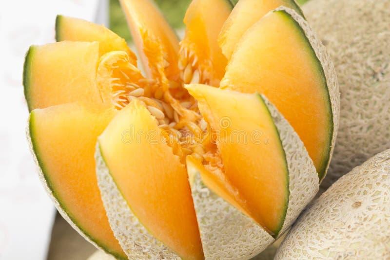 Cantaloupe Melon. Fresh fancy sliced cantaloupe melon on display at local farmers market stock image