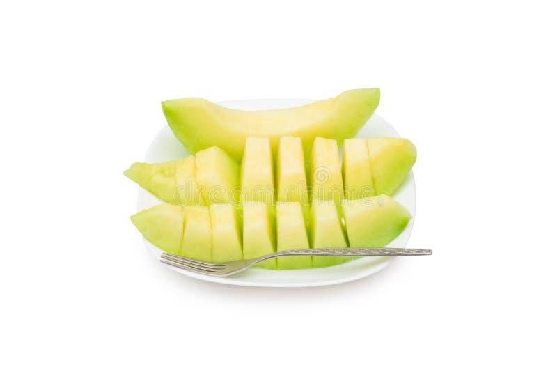 Cantaloupe melon fruit in dish Isolated on white background.  stock photo