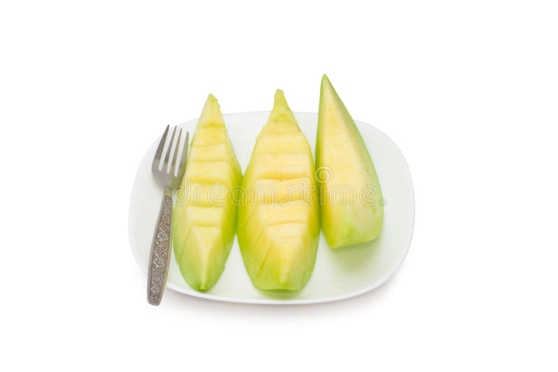 Cantaloupe melon fruit in dish Isolated on white background.  royalty free stock images