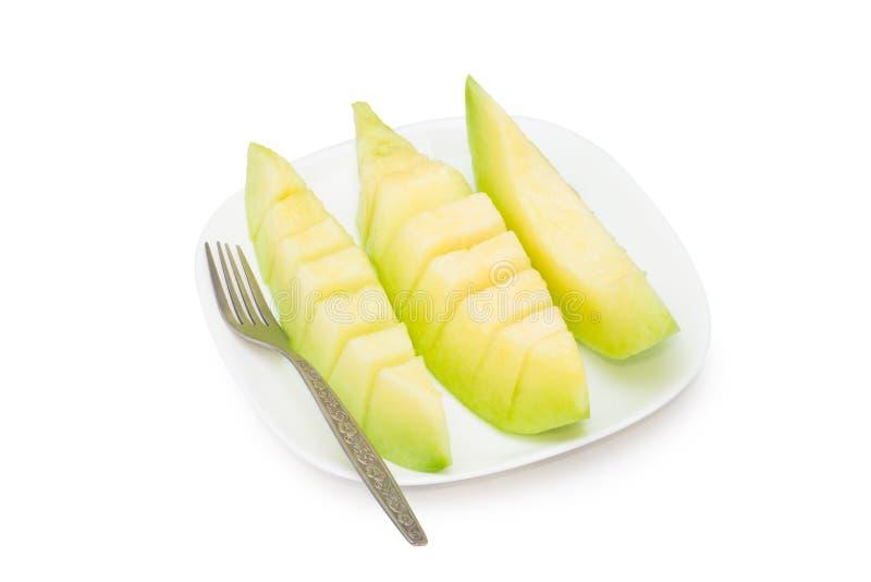 Cantaloupe melon fruit in dish Isolated on white background.  royalty free stock image