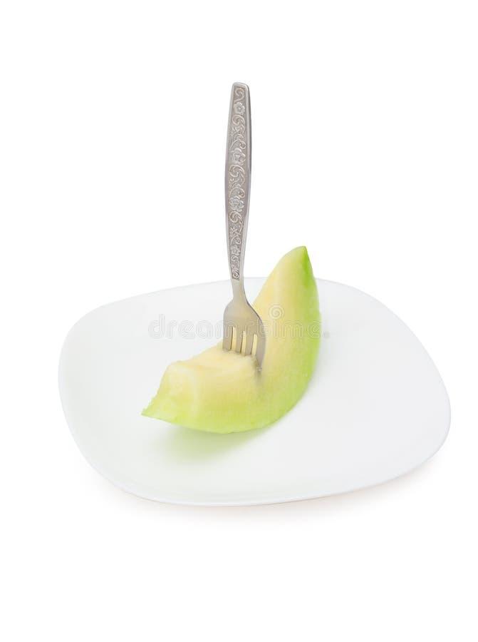 Cantaloupe melon fruit in dish Isolated on white background.  royalty free stock photo