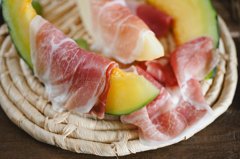 Cantaloupe melon and italian ham slices stock image