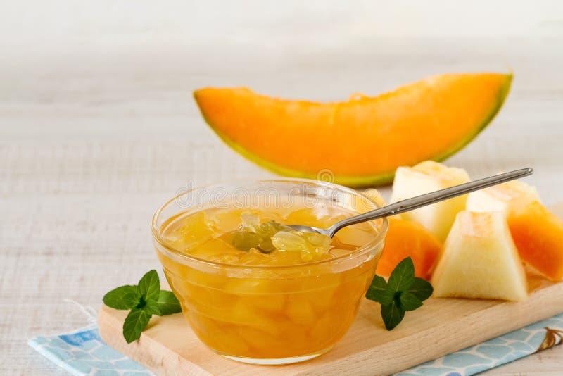 Cantaloupe melon jam. In a glass bowl on a table stock photos