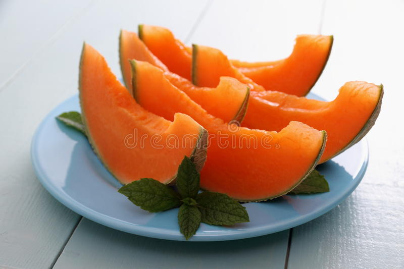 Cantaloupe melon with mint as healthy refreshment stock photos