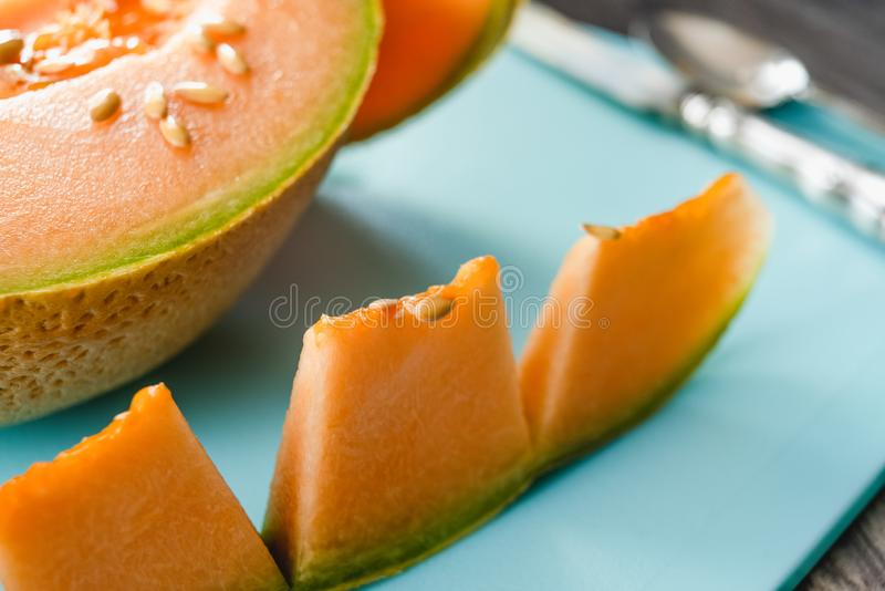 Orange Cantaloupe Melon Slices on a Chopping Board Close Up stock images