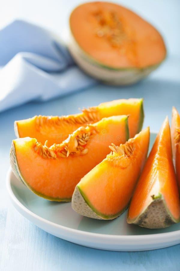 Cantaloupe melon sliced on blue plate royalty free stock photography