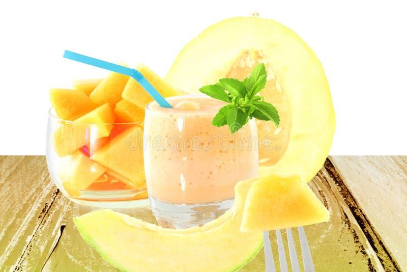 Cantaloupe melon smoothie or milkshake with fruit and stevia. Fresh Cantaloupe melon smoothie or milkshake with fruit and stevia in pure white background stock photo