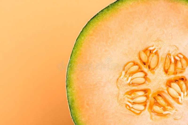 Cantaloupe Orange Melon Sliced in Half on Pastel Background,Close Up Detail stock photography