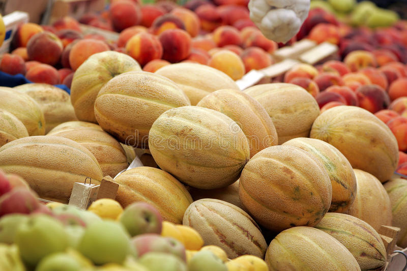Cantaloupe,peaches and apples royalty free stock images