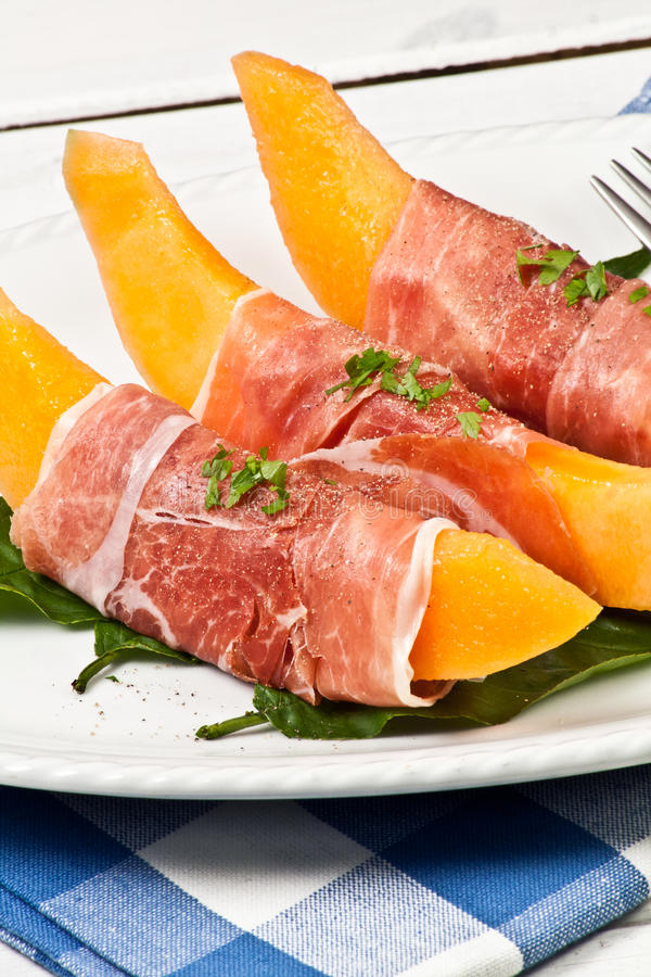 Cantaloupe and raw ham royalty free stock image