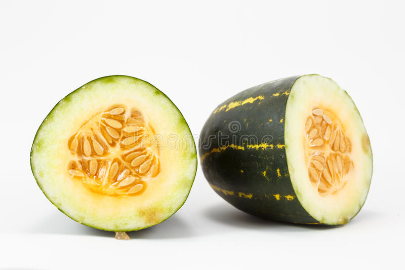 Cantaloupe, thailand melon. Cantaloupe, thailand melon cut half royalty free stock photo
